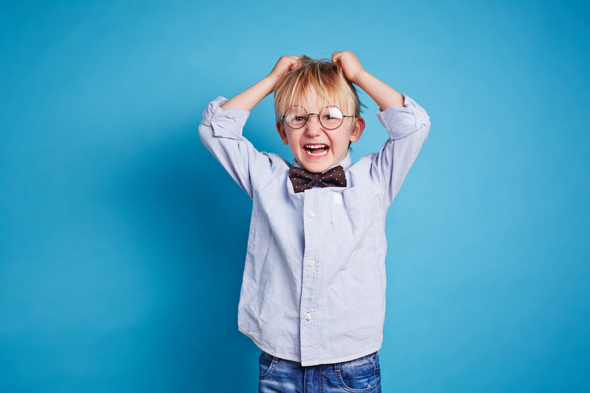 38803643 - little boy in smart casual expressing dissatisfaction